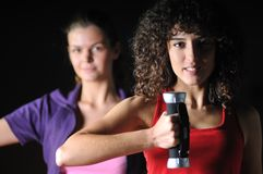 Two girls working out in fitness club Royalty Free Stock Photography
