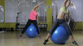 Two girls working out together by the bay.  stock video footage
