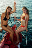 Two girls on yacht Stock Photos