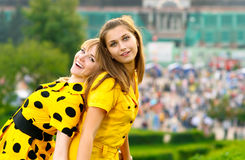 Two girls in yellow dresses Royalty Free Stock Photography