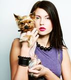 Two glamor girls with puppys. This image has attached release Royalty Free Stock Photo