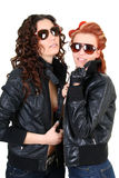 Two glamorous woman in leather jackets Royalty Free Stock Images