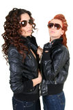 Two glamorous woman in leather jackets Stock Photo