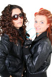 Two glamorous woman in leather jackets Stock Photos