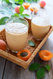 Two glases with Apricot smoothie Royalty Free Stock Images