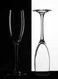 Two glass. One on white background and one on black royalty free stock photos