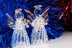 Two glass angel and Christmas tree Royalty Free Stock Photo