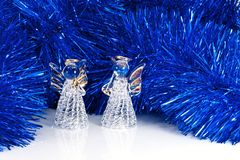 Two glass angel and Christmas tree Stock Photos