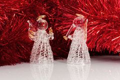 Two glass angel and Christmas tree Stock Image
