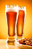 Two glass of beer and pizza Stock Images
