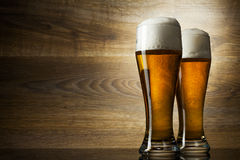 Two glass beer on wood background Stock Image