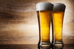 Two glass beer on wood background. With copyspace Stock Photography