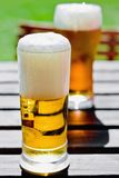 Two glass beers. In outdoor setting Royalty Free Stock Image