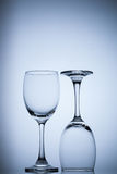 Two glass on blue gradient background space for text. Object Royalty Free Stock Images