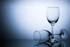Two glass on blue gradient background space for text. Object Royalty Free Stock Photography