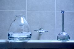 Two glass bottles in bathroom Stock Photos