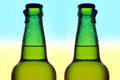 Two glass bottles of beer stock photography