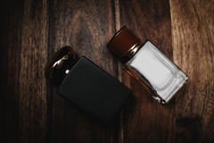 Two glass bottles of male perfume Royalty Free Stock Photo