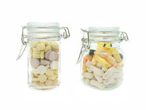 Two glass bottles with pills Royalty Free Stock Photos