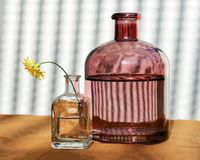 Two Glass Bottles and Wildflower Royalty Free Stock Photos