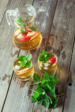 Two glass and carafe of green tea with mint and apples Royalty Free Stock Image