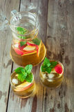 Two glass and carafe of green tea with mint and apples Royalty Free Stock Photography