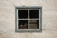 Two glass carafe in the window of an old house Royalty Free Stock Images