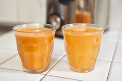 Two glass of carrot juice. On the table Stock Photos