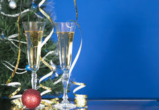 Two glass with champagne in blue style on table. Royalty Free Stock Photos
