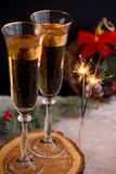 Two glass champagne glasses.Two beautiful glass champagne glasses on New Year`s Eve stock photos