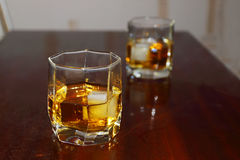 Two glass cup with whiskey and ice Stock Images