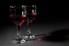 Two Glass Cups Filled With Red Wine Isolated on Black Royalty Free Stock Photo