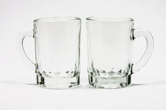 Two glass cups with handle Royalty Free Stock Photography