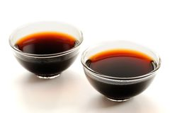 Two glass cups with puerh tea Stock Photos