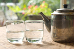 Two glass cups and steel teapot Stock Photography
