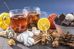 Two glass cups of tea with lemon and sweets Stock Photo