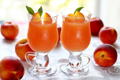Two glass of fresh juice from ripe fruits Stock Images