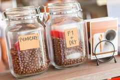 Two glass jar of coffee beans Royalty Free Stock Photos