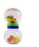 Two glass jars with colorful candy Stock Photo