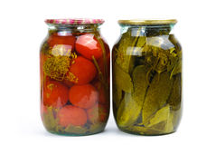 Two glass jars of colorful pickled vegetables Stock Photography