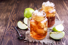 Two glass jars with iced tea on rustic background Stock Image