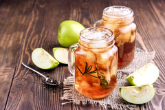 Two glass jars with iced tea on rustic background Stock Photo