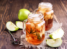 Two glass jars with iced tea on rustic background Royalty Free Stock Photography