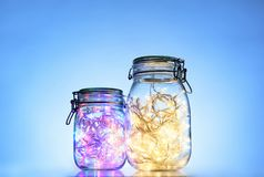 Two glass jars with light garlands inside Royalty Free Stock Photography