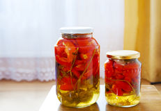Two glass jars with marinated tomatoes homemade Royalty Free Stock Photo