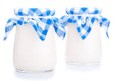 Two glass jars of yogurt isolated on white background Royalty Free Stock Photo