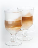 Two glass mugs with handles of latte coffee Stock Photo