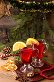 Two glass of mulled wine over on wooden table. Stock Image