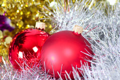 Two glass New Year's balls in a tinsel. Removed close up Royalty Free Stock Photo