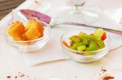 Two glass rosette with croutons and vegetables. Stock Images